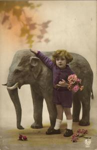 Young Girl in Purple Clothes with Small Elephant (1920s) Tinted RPPC Postcard