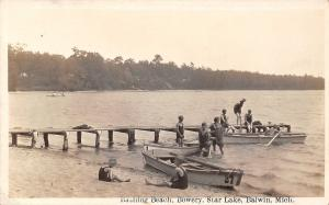Baldwin Michigan~Star Lake~Bathing Beach~Bowery~Kids in Boats~Dock~1920 RPPC