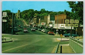 Black River Falls WI~Main Street~County Bank~Hardware Store~Hwy Signs~1960s Cars