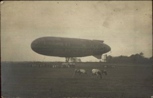 Dirigible Airship Blimp in Field w/ Cows c1910 French Real Photo Postcard