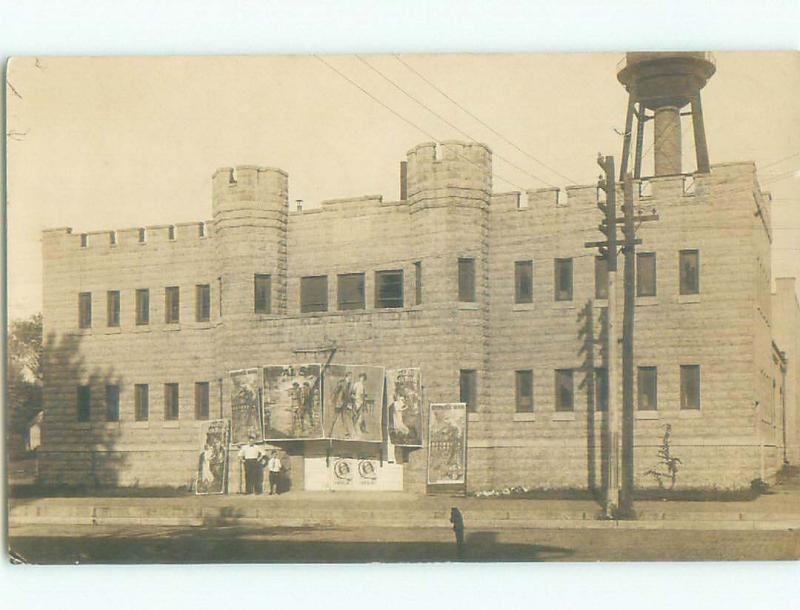 Pre-1920 rppc LARGE POSTERS OUTSIDE BUILDING Postmarked Geneseo IL i7816