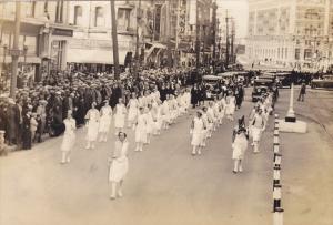 RP; Parade, WINNIPEG, Manitoba, Canada, 1931; Women marching ahead of caravan...