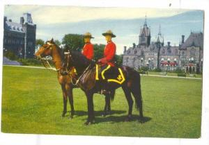 Two Members of the Royal Canadian Mounties on Horseback,Canada, 40-60s