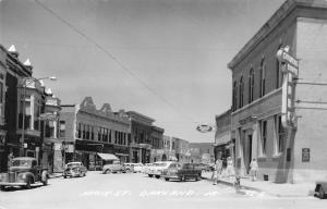 Oakland Iowa~Main Street~Bank~Rexall Drug~Cafe~1940s Pickup Truck~1950 Cars~RPPC