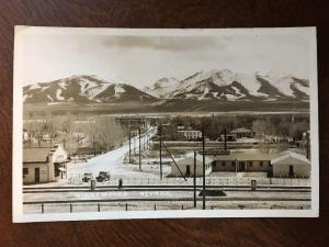 RPPC 1950s' Winnemucca, Nevada, Western Inn at Train Tracks, Winter Z3