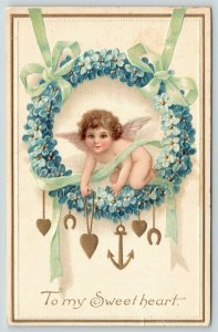 Valentine~Cherub Cupid in Forget-Me-Not Wreath Hangs Heart Anchor~Lime Ribbons