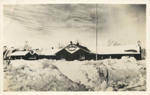 Gilbert Lodge~Skis Imbedded in Snow Bank~Real Photo Postcard c1950