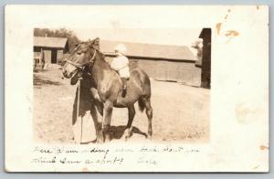 Monticello Iowa~Little Leola Gerdes on Horseback~Farm Barnyard~c1916 RPPC