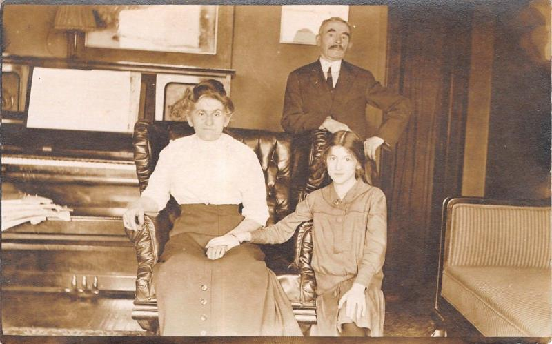 Real Photo Postcard~Victorian Family~Before Upright Piano~Grandparents~1915 RPPC