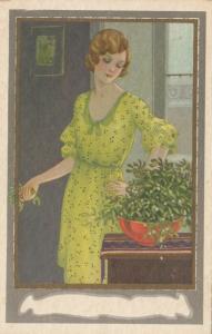 ART DECO ; Female in a green dress with bowl of mistletoe, 1910-20s