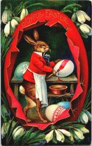 Anthropomorphic rabbit painting Easter eggs in egg-shaped workshop wonderful