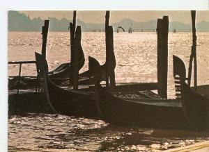 Postal 032218 : Venezia. Ferry with gondolas at the sunset
