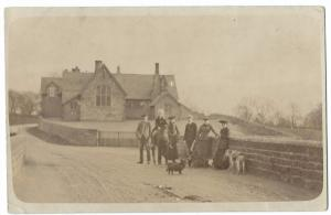 Family Group in Front of Unidentified Schoolhouse RP PPC, Unposted