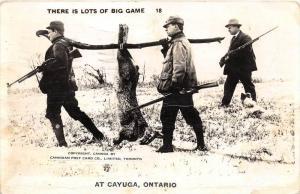 8440  Ontario Cayuga   Hunters Carrying Giant Rabbit  RPC