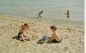 PORT RYERSE , Ontario , 1950-60s ; Children playing on the beach & in the water