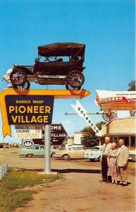 Minden NE Pioneer Village Entrance Covered Wagon Old Cars Signs Postcard