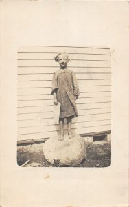 F40/ DeGraff Minnesota RPPC Postcard 1911 Girl Standing on Round Boulder