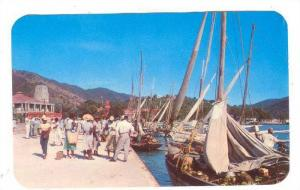 Sail boats bring sea-food, vegetables, fruit, from neighboring islands in St....