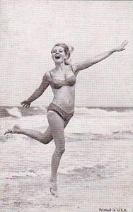 Pin-up girl jumping the waves in a bikini, 30-50s
