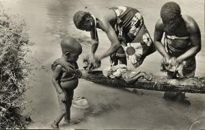 Black Africa, Native Girls Washing in River, Young Boy Watching (1962) RPPC