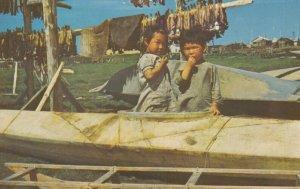 Eskimo children in Sealskin Kayak , Arctic Region , Alaska , 1950-60s