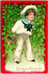 1909 CHRISTMAS Greetings Embossed Postcard Boy in Sailor Suit Gold Bell & Holly