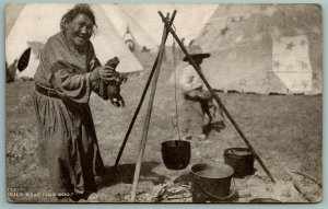 Native Americana~Indian Woman About To Toss Puppy Into Pot of Boiling Water~1910