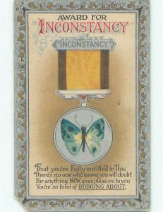 Pre-Linen BUTTERFLY ON INCONSTANCY MEDAL ON POSTCARD J0475