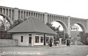 Nicholson PA Esso Gas Station Coca-Cola Sign RPPC Postcard