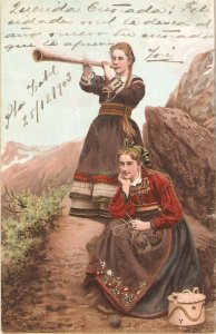 Two ladies in typical dress, in moiuntain Old vintage antique German Postcard