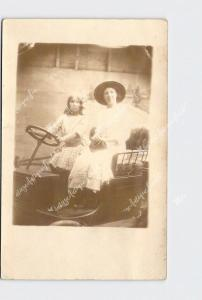 RPPC REAL PHOTO POSTCARD SOUVENIR PICTURE ANTIQUE CAR WOMAN AND GIRL DRIVING SOU