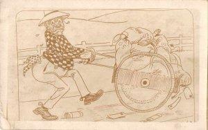 Man Pushing Wheelbarrow of US Mail Bags Comic Real Photo Vintage JI658587