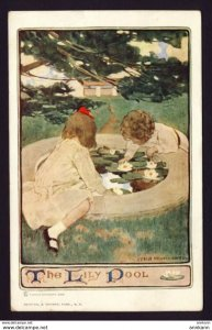 Two girls playing in pond. THE LILY POOL. Jessie Wilcox Smith artist