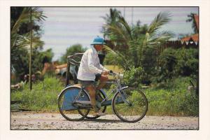 Trishawman on bicycle , Malaysia , 60-80s