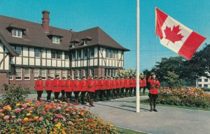 Canada , 1950-60s ; Royal Canadian Mounted Police raising new flag