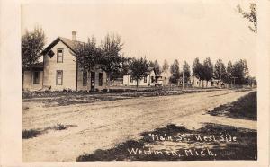 Weidman Michigan~Newer Homes on West of Dirt Main Street~RPPC c1915
