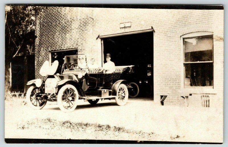 Real Photo Postcard~Trio of Gus Vintage Car Leaving Brick Garage~RPPC c1910