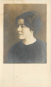 Angle View of Woman in Black~Hair in Bun~Real Photo Postcard c1918