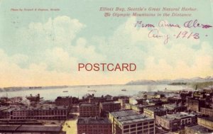 1913 ELLIOTT BAY, SEATTLE'S NATURAL HARBOR, OLYMPIC MOUNTAINS IN THE DISTANCE