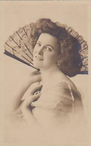 RP; Portrait of woman holding hand fan, 10-20s