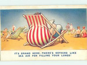 Bamforth comic FAT WOMAN SITTING ON STRAIGHT CHAIR AT BEACH HJ2851