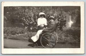 RPPC Wife Nurses Convalescing Husband~Take Garden Stroll~Wicker Wheelchair~c1914