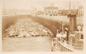 LPS18 Seattle Washington U.S. Government Locks Boom of Logs Postcard RPPC