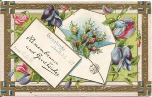 Envelope filled with pink roses Violets decorate this Vintage Postcard Greetings