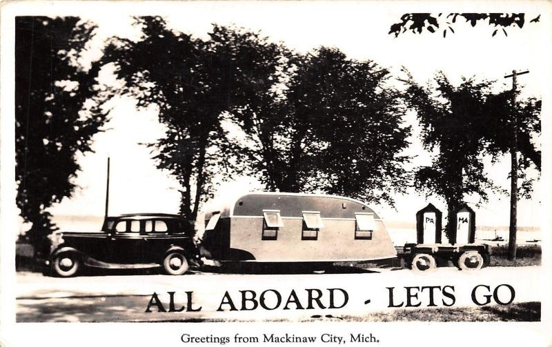 Mackinaw City Michigan~All Aboard~1930s Car Pulls Travel Trailer~Out Houses~RPPC