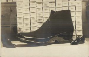 Adv -Giant Novelty Shoe on Table w/ Boxes c1910 Real Photo Postcard dcn