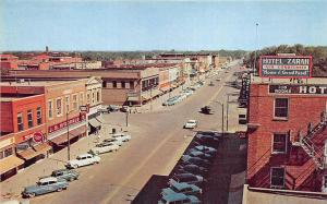 Great Bend KS Street View Store Fronts Billboards Old Cars Postcard