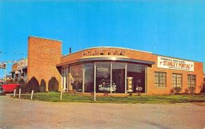 Liberty MO Henry Stanley Pontiac Car Dealership Postcard