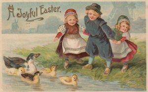 EASTER, PU-1911; Dutch children watching ducks in the water