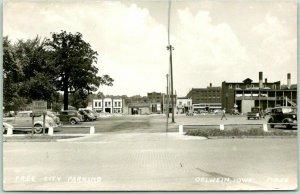 OELWEIN, Iowa RPPC Real Photo Postcard FREE CITY PARKING Downtown Street Scene